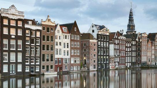 Merchant houses along the Damrak at sunset, Amsterdam.