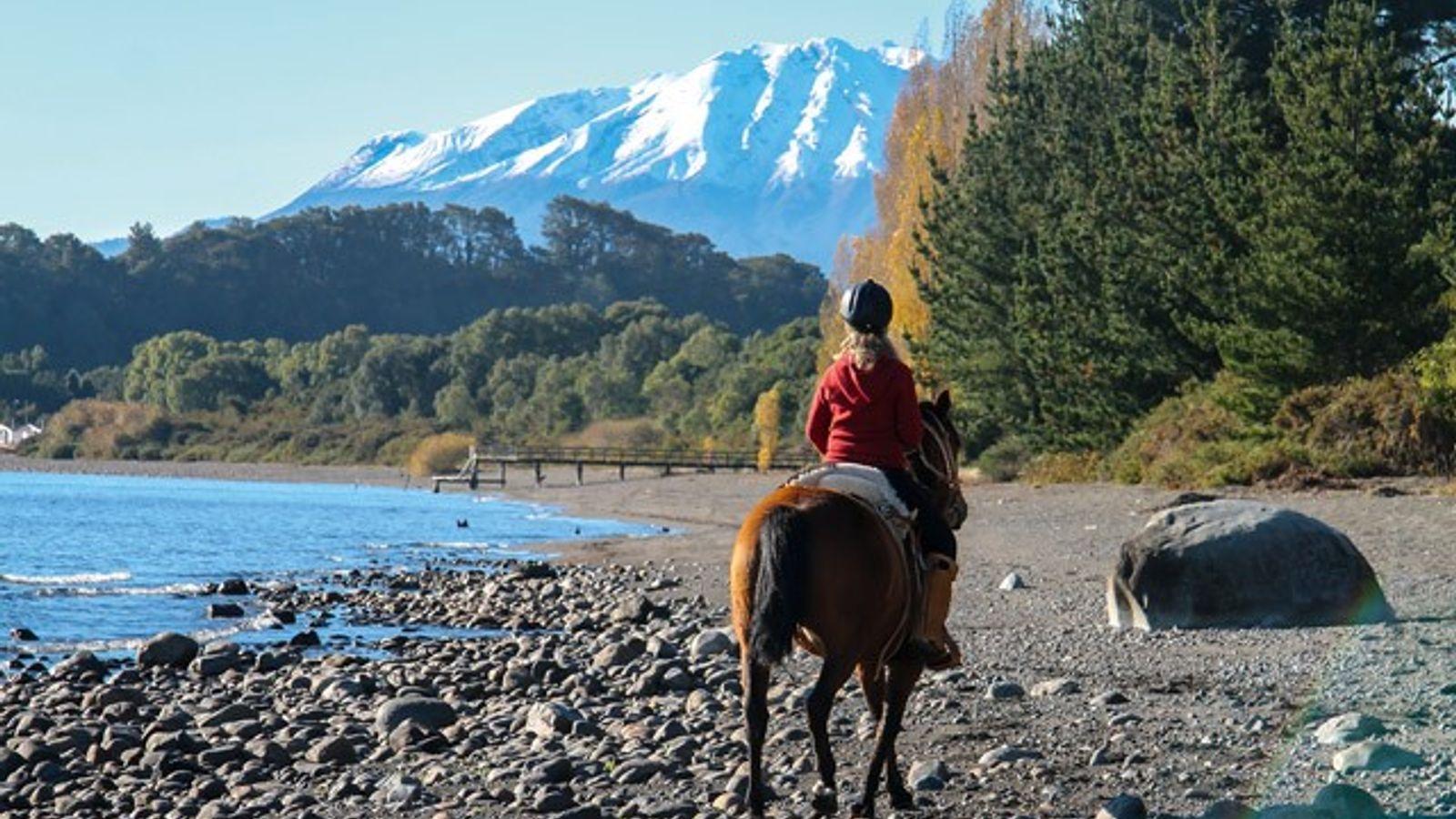 On horseback with views over Lake Llanquihue, Puerto Rosales Peninsula.