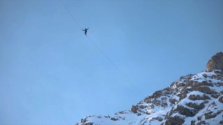 Champion Slackliners Cross Between Frozen Waterfalls in the Alps