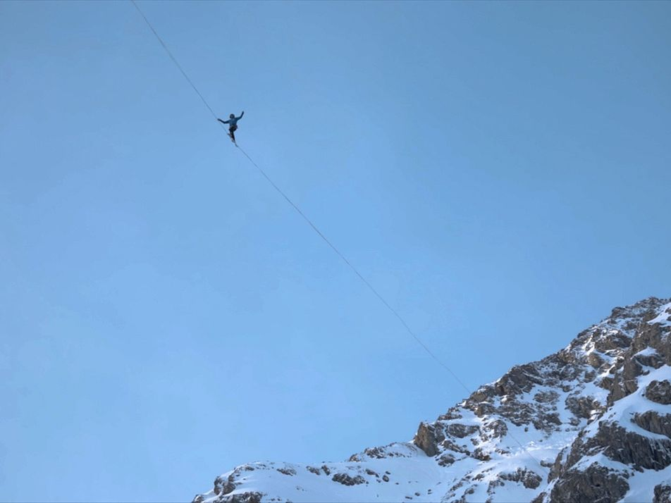 Champion High Wire Performers Cross Between Frozen Waterfalls in the Alps