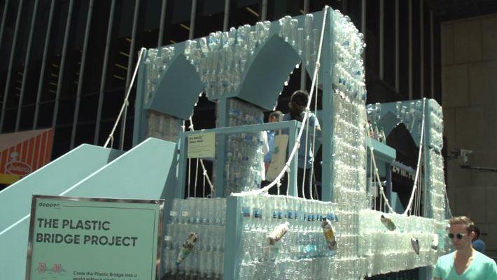 Artists Used 5,000 Bottles to Build Brooklyn Bridge Replica