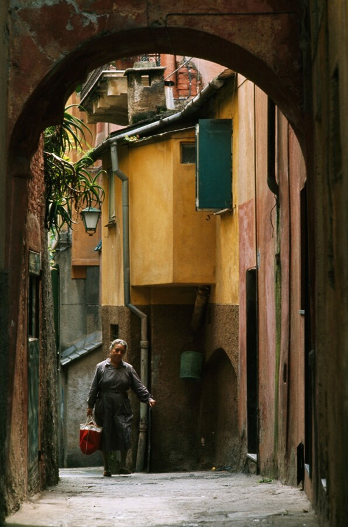 A woman walks residential streets in Portofino, North-western Italy. The town, located on a peninsula south-east ...