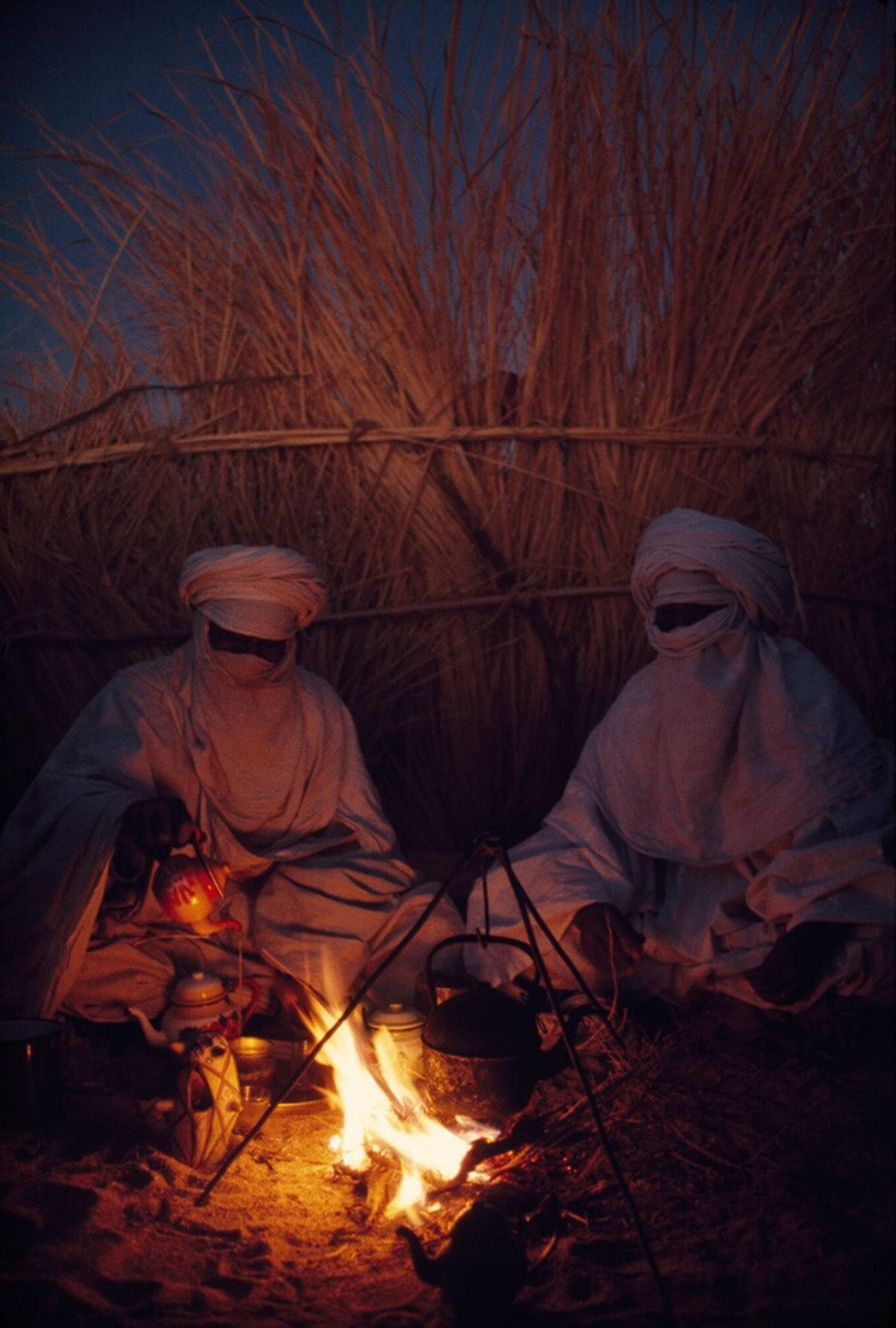 Algeria, 1973: Tuareg goat herders drink tea at their camp at Hassi Izernene, Algeria. The Tuareg, ...