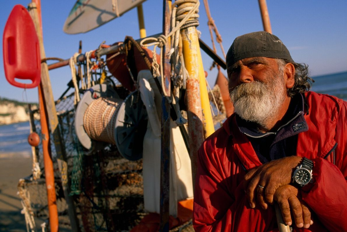 A fisherman rests on the beach at Peschici, in Italy's Foggia province. Located near the so-called ...