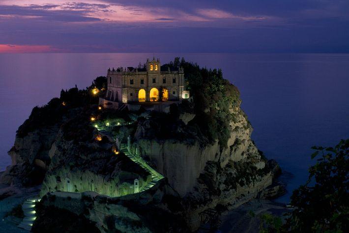 A night-time view of Santa Maria della Isola sanctuary, off the coast of Calabria in Southern ...