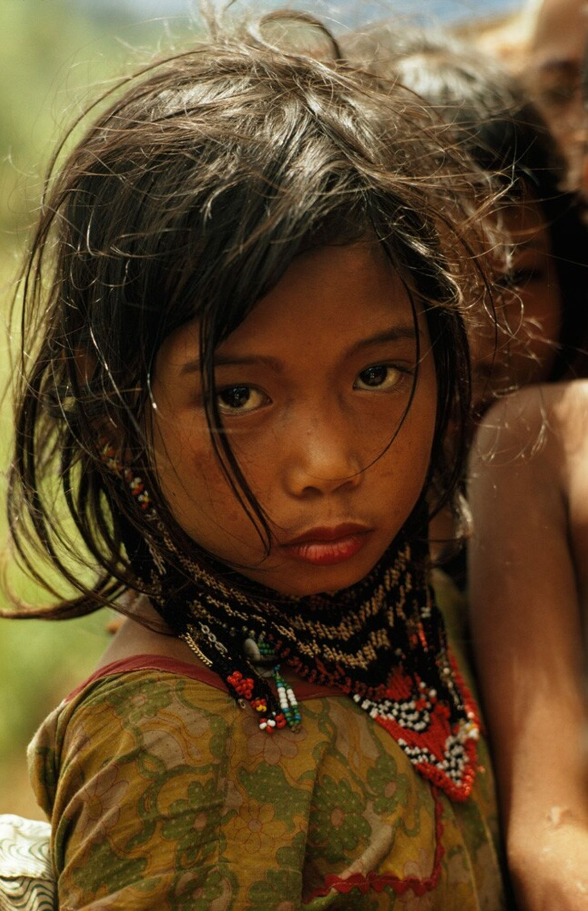Phillippines, 1971: a young Ubo girl, dressed in traditional jewellery, on Mindanao Island. The Ubo are ...