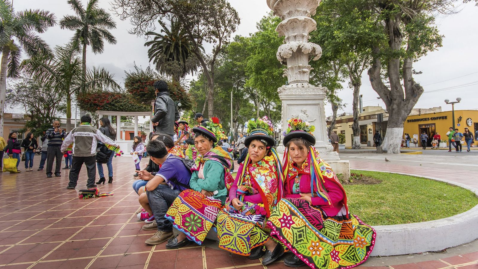 Peruvian women in Barranco dressed in the traditional clothing of Cusco and the mountains