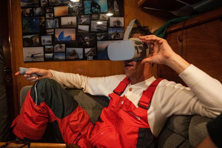 Using VR goggles, Fabrice Schnöller views 360-degree underwater footage.