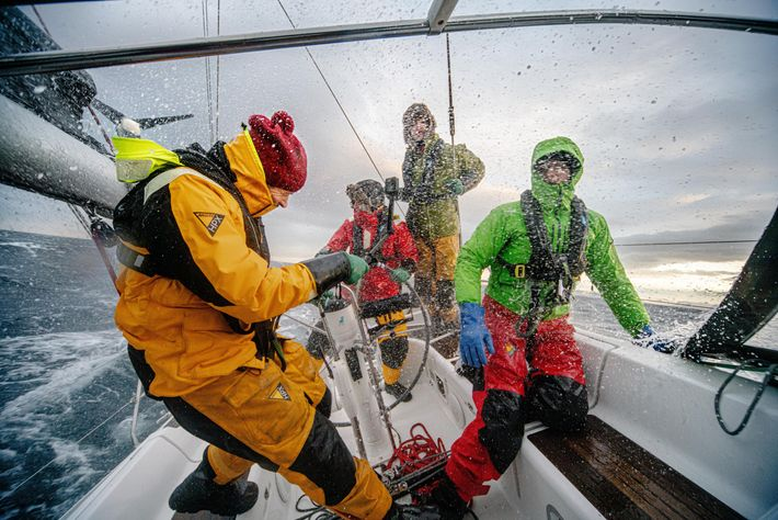 Andreas B. Heide, Emil Gundersen and Aksel E. Ørstavik and Hugh Francis Anderson (left-right) brave 40-knot gusts on the deck ...