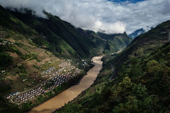 Mian Gu Village on the Nu River is a government housing project designed to encourage people ...