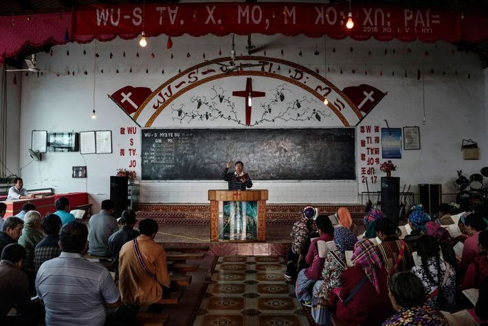 Ethnic Lisu villagers attend Easter service at a Protestant church on the bank of the Nu ...
