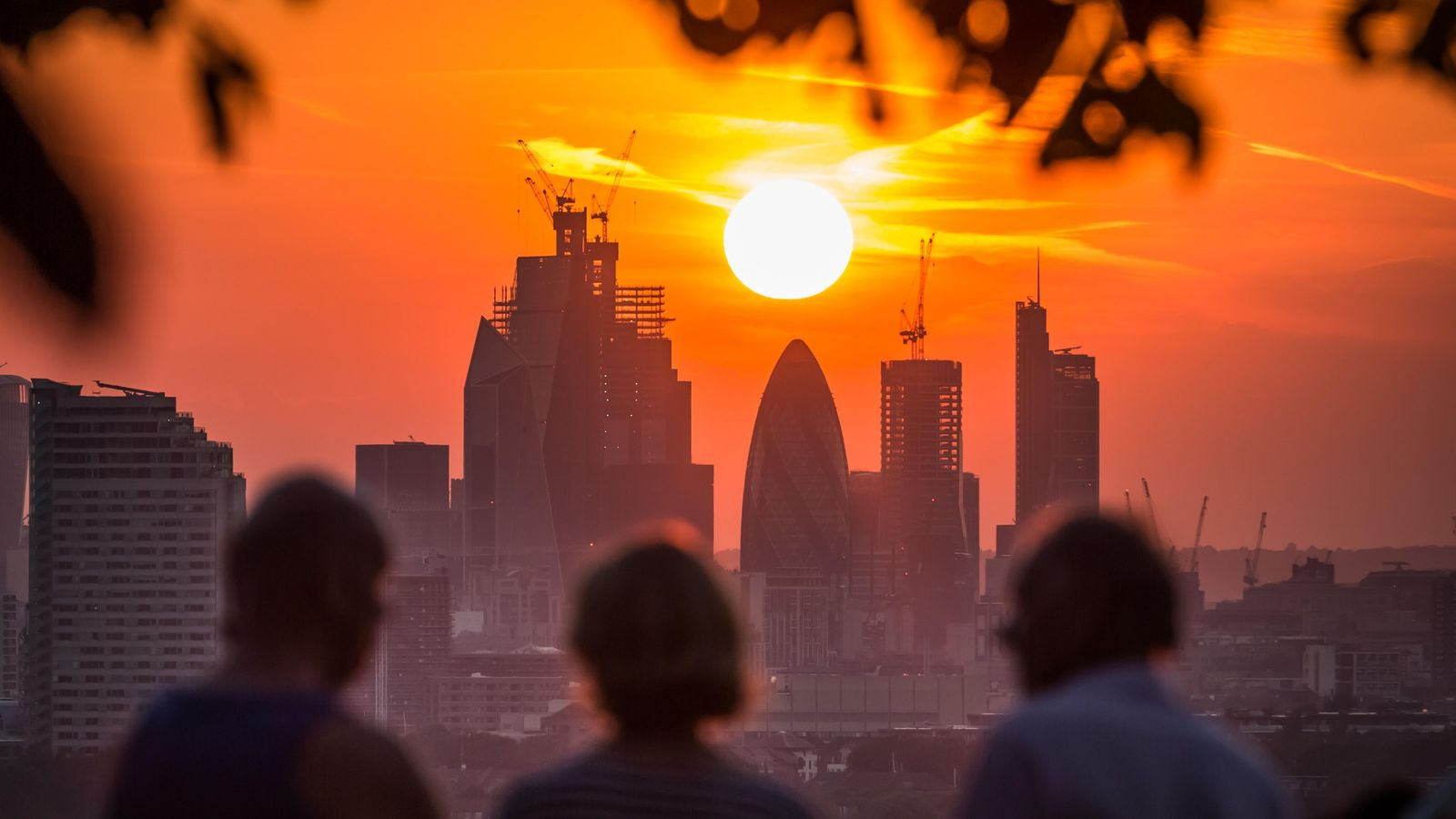 London, July 5th 2018: Londoners watch the sunset from Greenwich park during a summer heatwave in ...