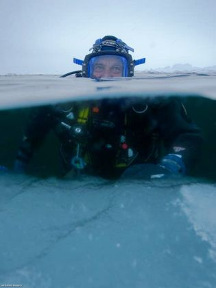 Paul diving in the Northwest Passage whilst leading the Pristine Seas Last Ice expedition.