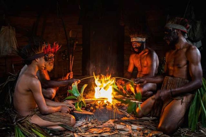 Medicine man and villagers in a Tokua hut. Image: Celia Topping