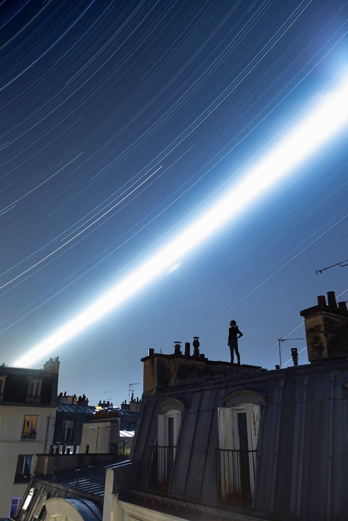 A striking view of the moon's transit across the Parisian rooftops presented many challenges in terms ...