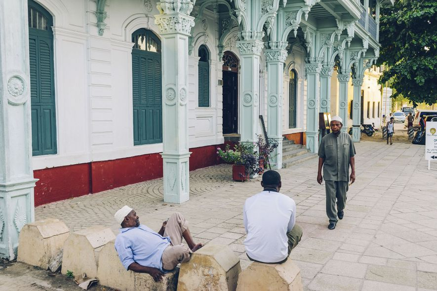 Men relaxing outside Stone Town's Old Dispensary building.