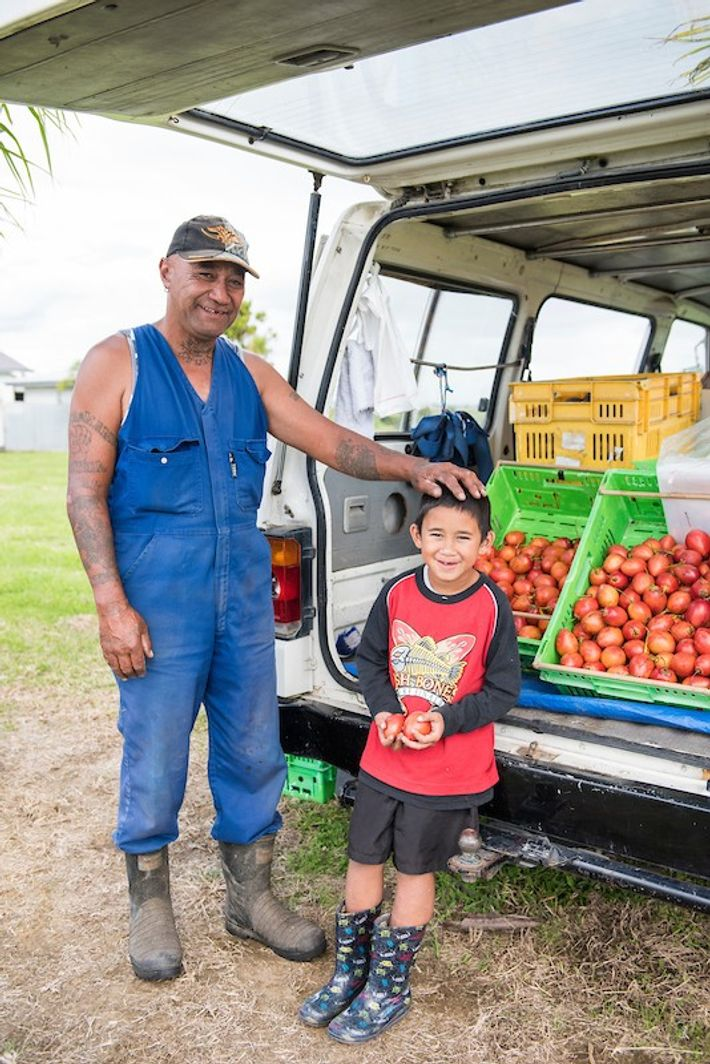 Frank Walters and his grandson, Arcadian Drewet, sell tamarillos and kumara (sweet potatoes) from their roadside ...