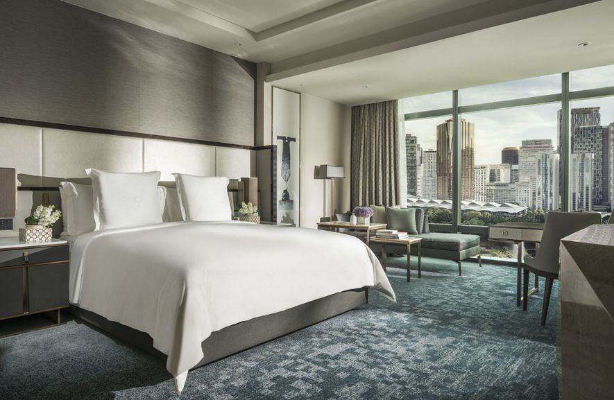 Check in to the Four Seasons in the Malaysian capital of Kuala Lumpur as part of ...