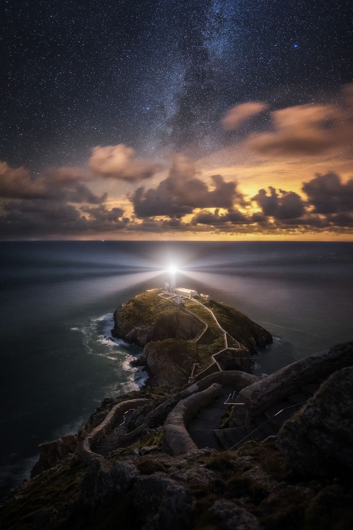 """Alyn Wallace: """"The Great Rift of the Milky Way extends above South Stack lighthouse on Anglesey. ..."""