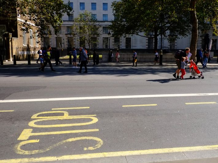 Demonstrators of all ages move along Whitehall towards Westminster.