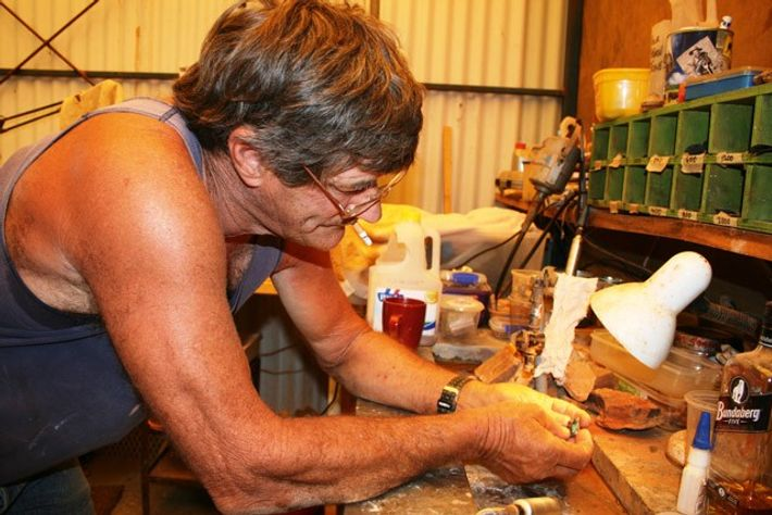Daryl Bonham cutting opal in his shed. Image: Max Anderson