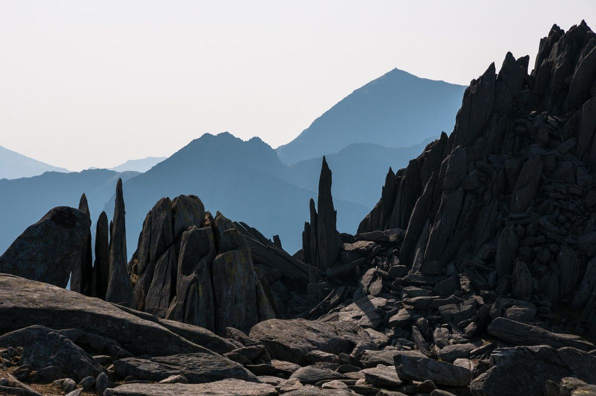 A view of Snowdon from the summit of Castell y Gwynt, in the Glyders range. Slate ...