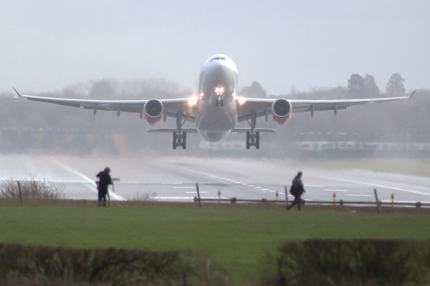 Disruption caused by reported drone sightings recently caused massive delays at Gatwick. Here photographers are shown ...