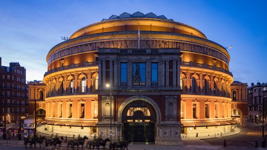 The modern Royal Albert Hall is in South Kensington, adjacent to the Royal Geographical Society.