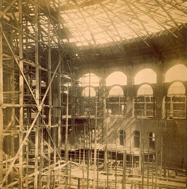Scaffolding supports the interior of the hall during construction in the 1860s.