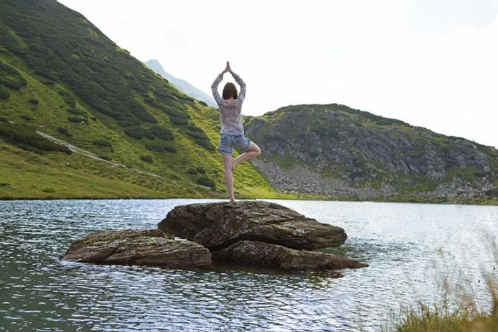 Yoga in the mountains of Salzburgerland. Image: Getty