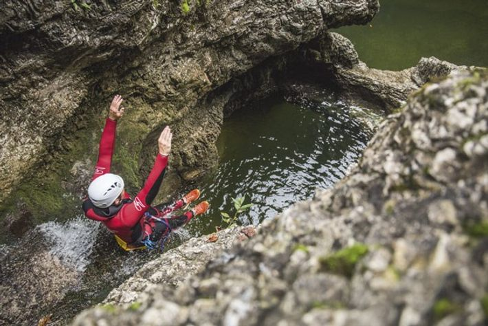 Taking the plunge in Almbach Gorge. Image: Michael Groessinger