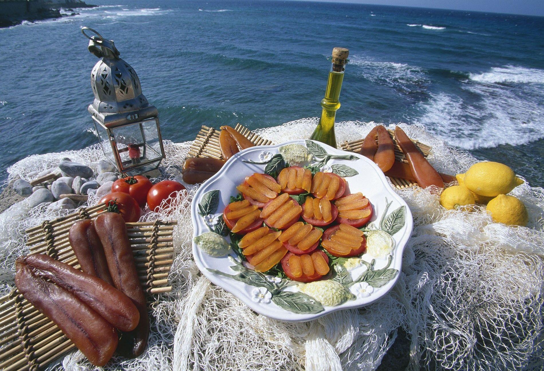 Bottarga of Muggine display by Moreno Cecchini on Alghero beach.