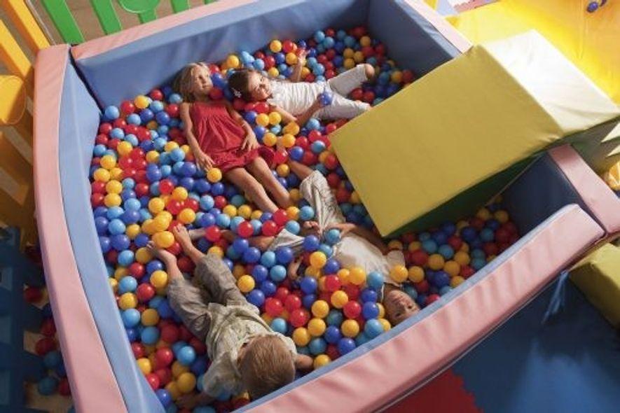 Kids playing in ball pool, Sardinia.