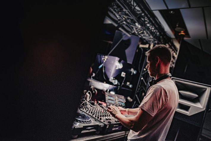 DJ on the decks at Amsterdam Dance Event.