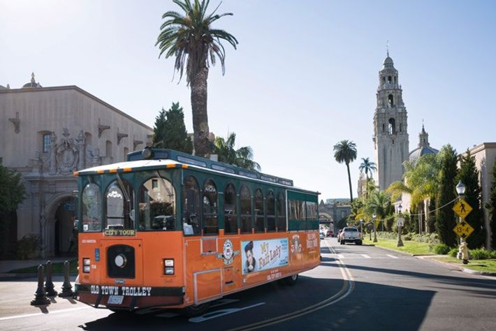 The Old Town Trolley Tour turns out of Balboa Park.