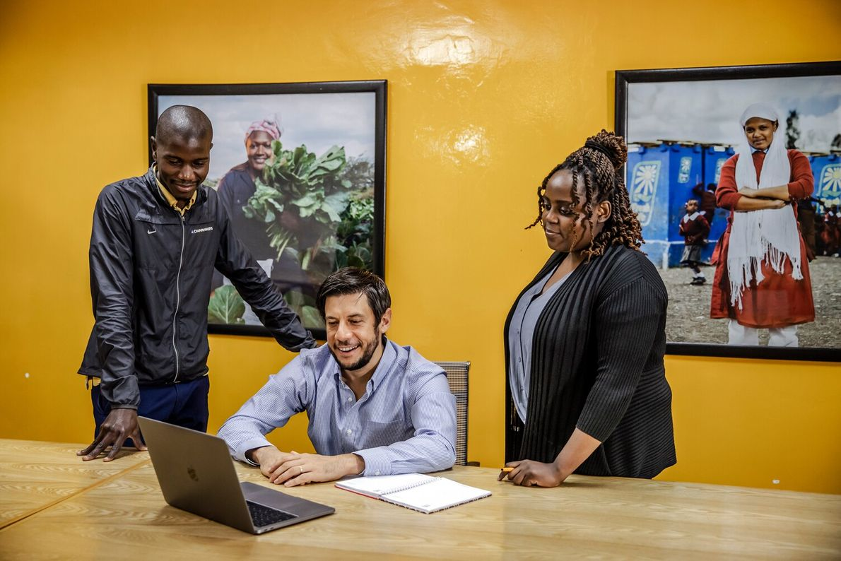 Co-founder David Auerbach (centre) with Sanenergy team members at their offices in Nairobi.