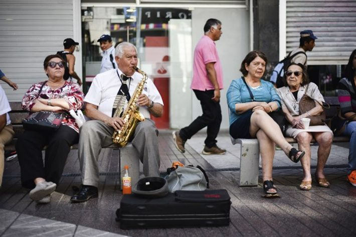 A local playing the saxophone in downtown Santiago.