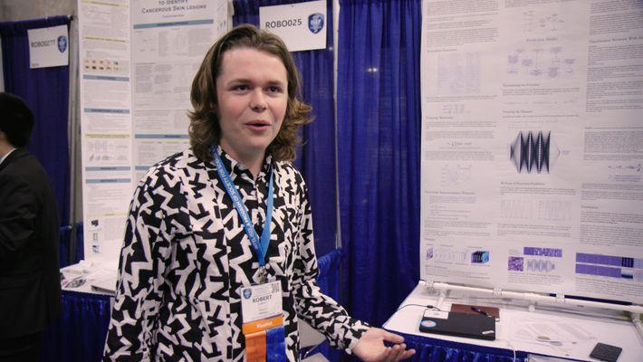 Robbie Barrett in front of his ISEF presentation board.