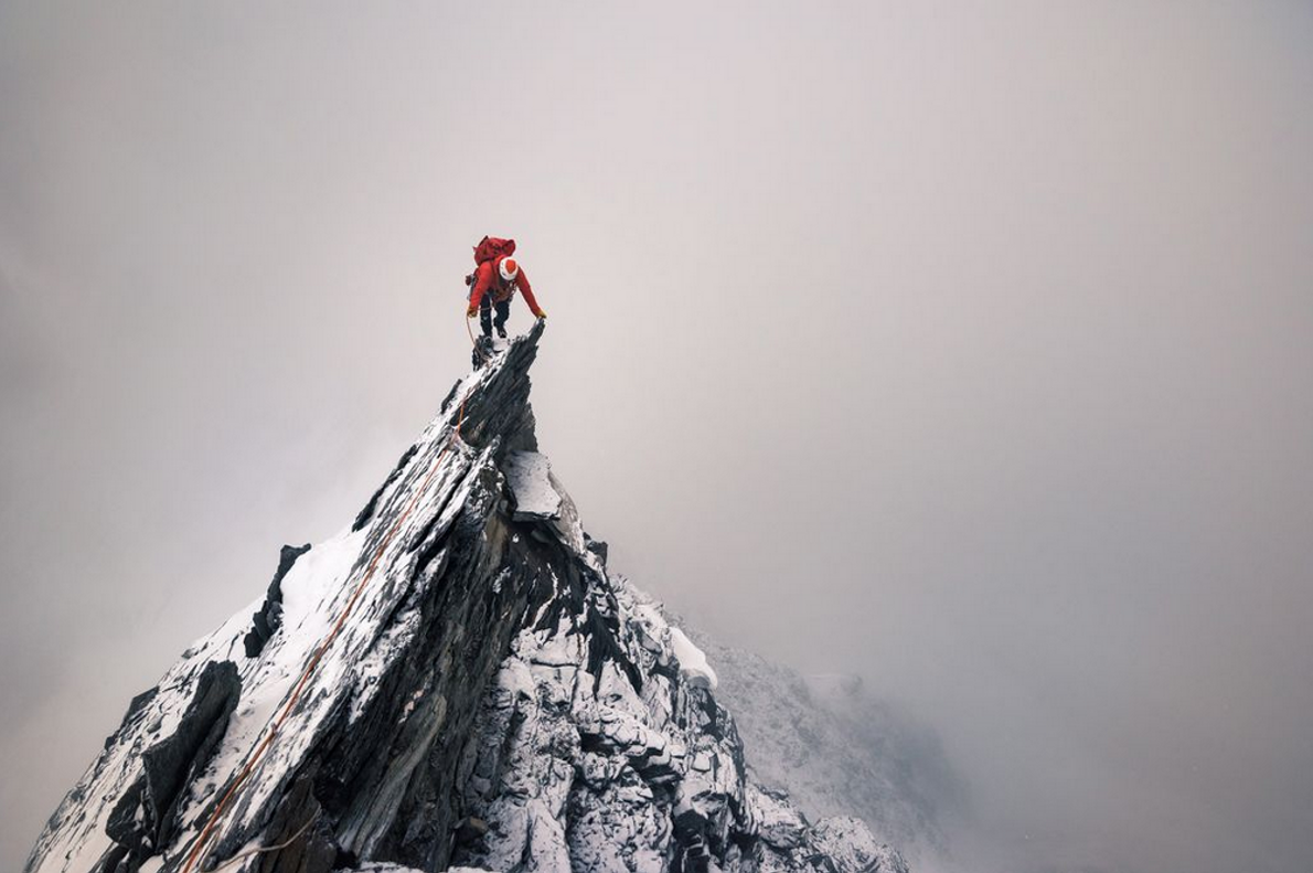 A climber stands atop the jagged peak of the Täschhorn in the Swiss Alps. Your Shot ...