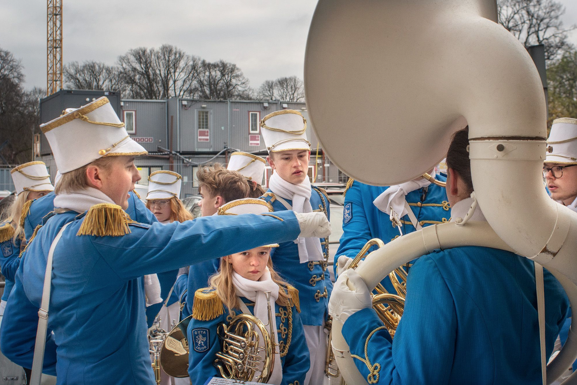 Members of a youth marching band in Göteborg, Sweden, take a break to compare marching methods. ...