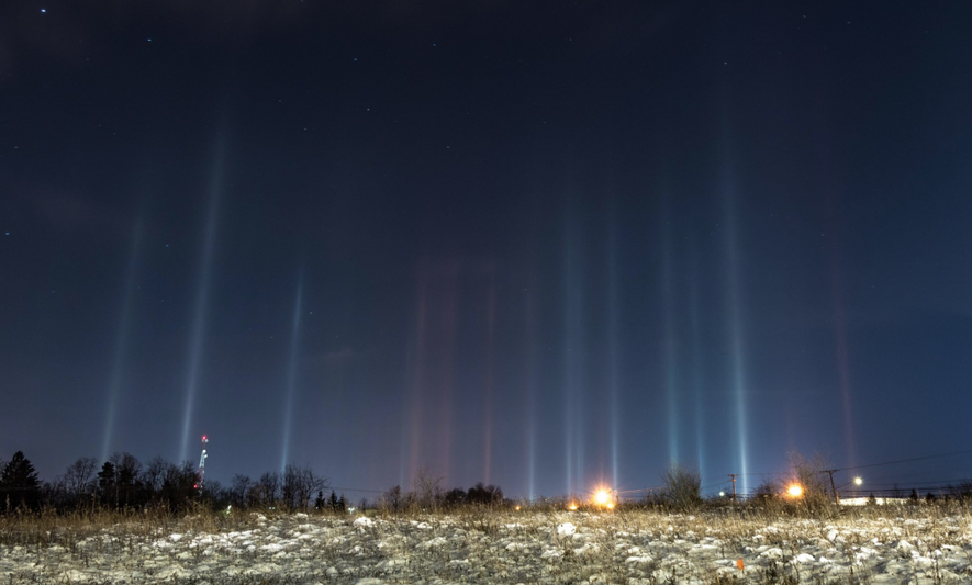 What Causes These Pillars of Light to Form in the Atmosphere?