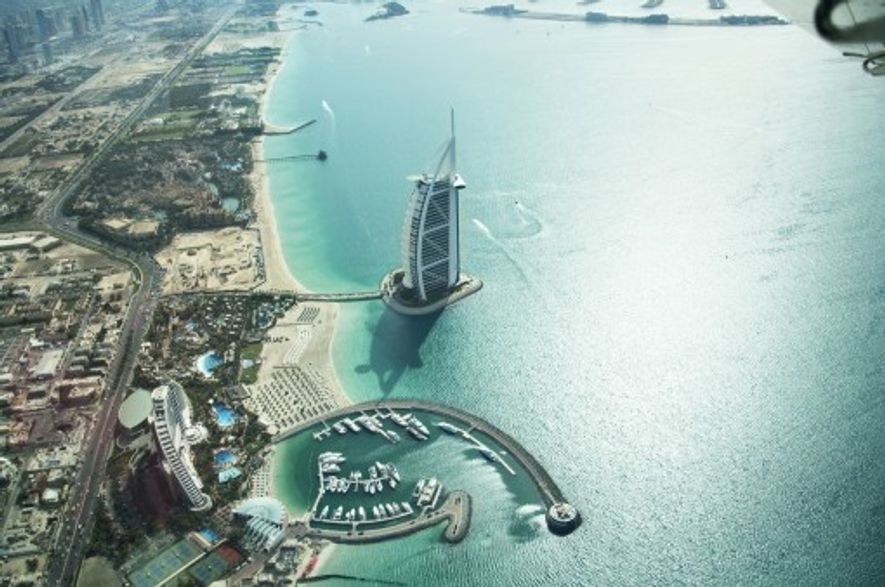 Get an aerial view of Dubai's iconic architecture on a flight over the city. Image: Seawings.