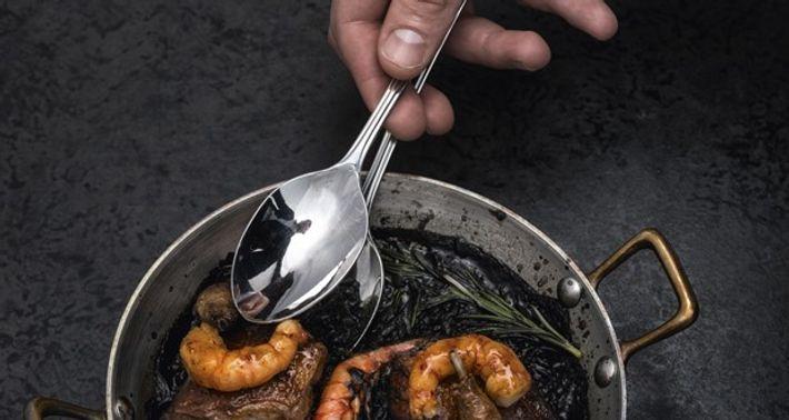 Pigeon with arroz negro, black pudding and prawns