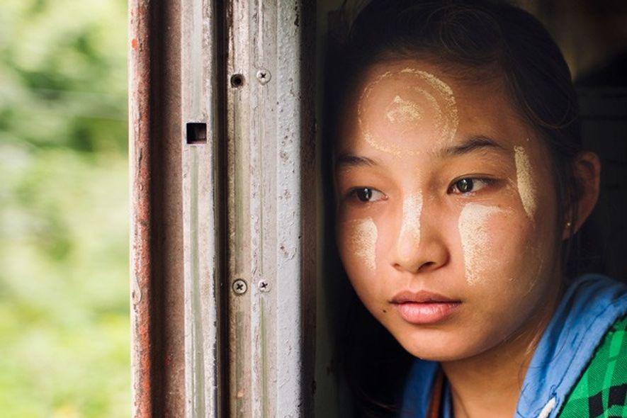 Girl on The Mandalay Express, Myanmar.