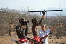 Shivani Bhalla tracking lions using GPS, with Samburu Warriors.