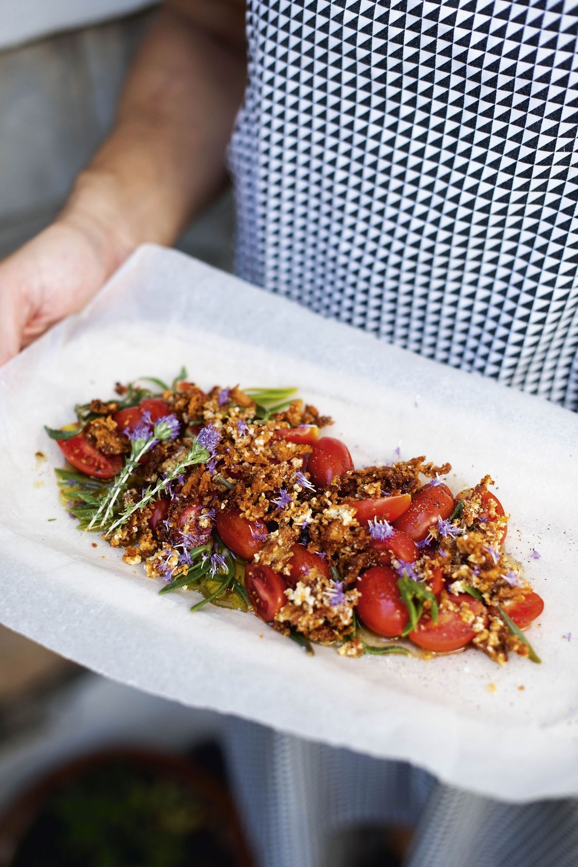 Fried manoura with cherry tomatoes and thyme flowers, served at Zoi and Alberto's home.