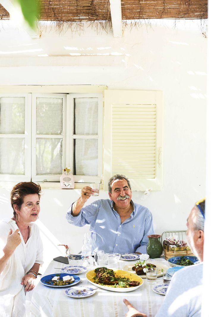 Kostas raises a glass.