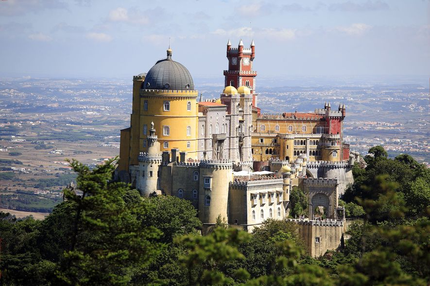 Sintra is home to Pena Palace, a gaudy, red-and-yellow 19th-century castle surrounded by wild, sprawling gardens.