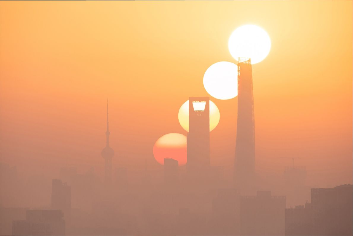 Utilising the narrow window of time when the sun can be observed rising over Shanghai's central ...