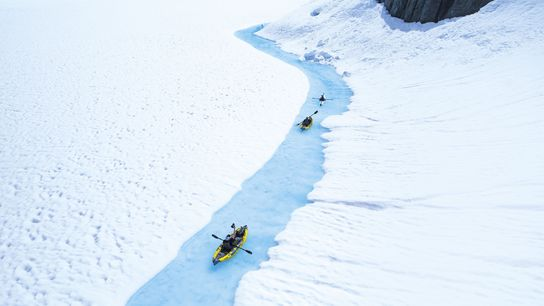 Kayaking on a semi-frozen lake, British Columbia, Canada